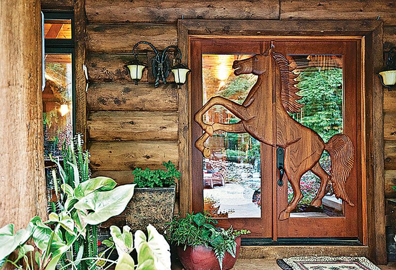 Close your eyes and picture a log home: Most likely, in your imagined house, there's a wood door.
