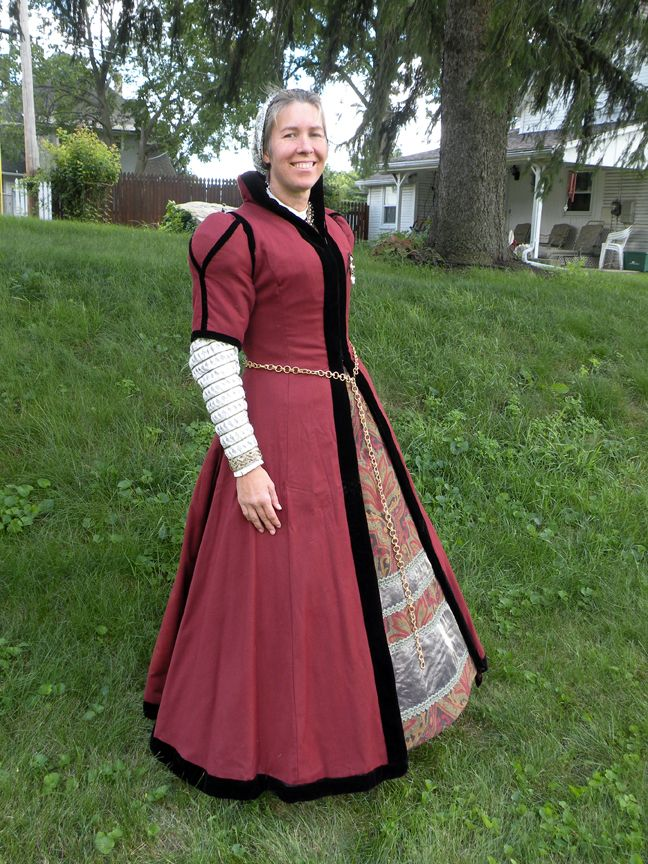 The gown is russet wool lined with brown linen. It hooks up the ...