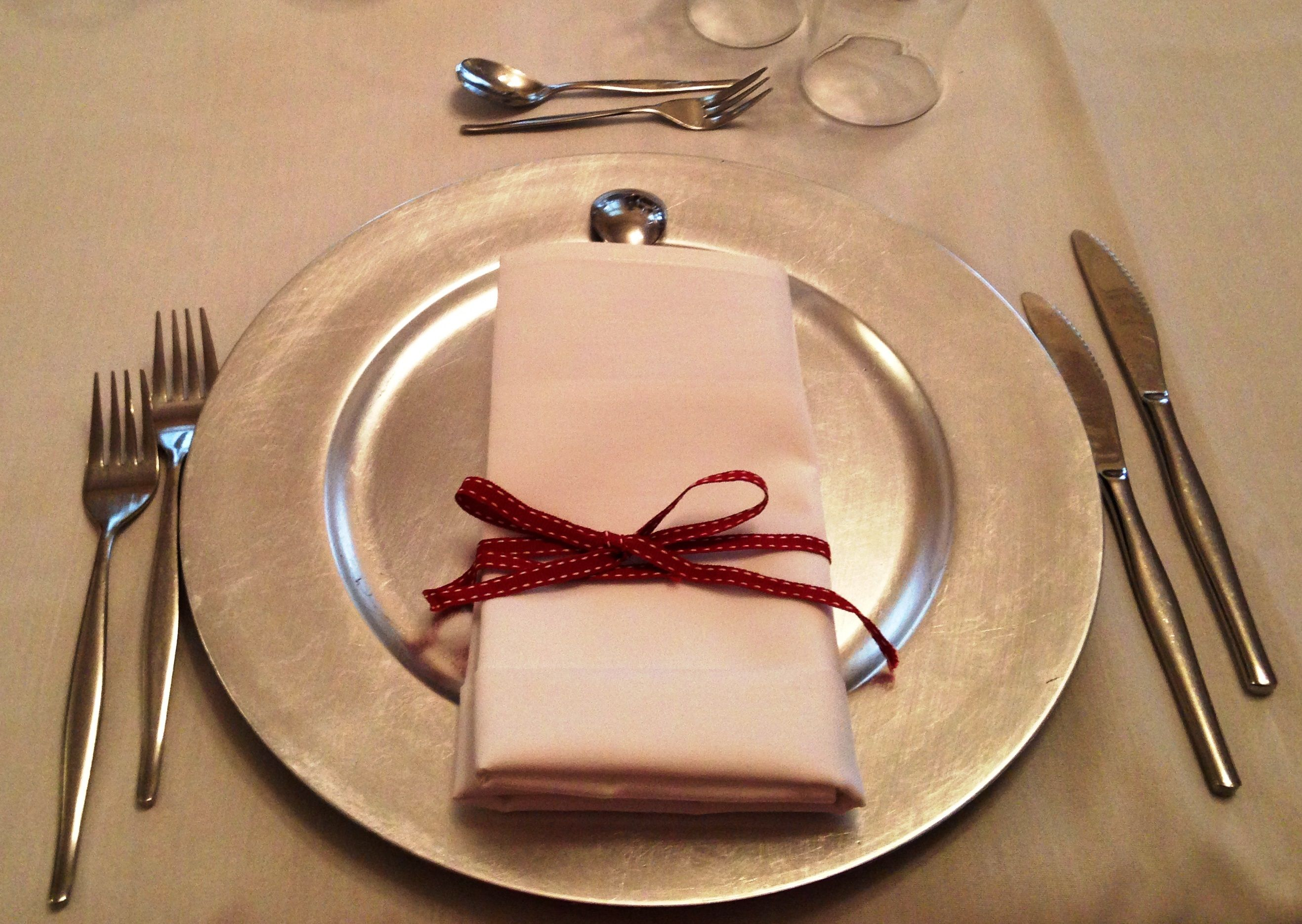 Silver charger plate with red ribbon wedding decorations abbey of silver charger plate with red ribbon wedding decorations abbey of the roses qld australia junglespirit Choice Image