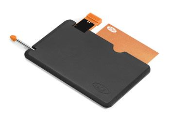 A pen, flash drive, and notepad in a credit-card-size case.