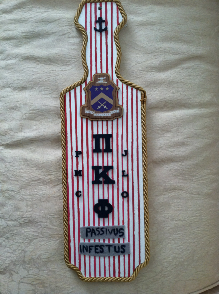 Fraternity paddle- like the lining and the vertical stripes/layout ...
