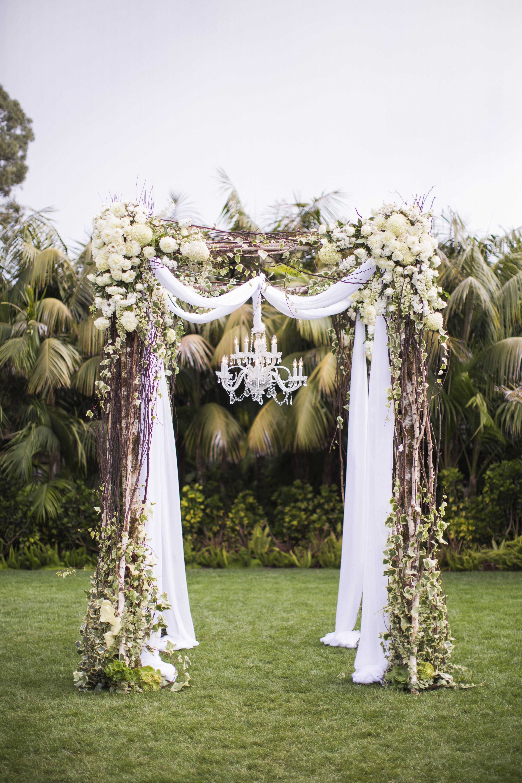 A Dazzling Wedding Arch With Sparkly Chandelier On Monte Vista Lawn Luxbride Fourseasons