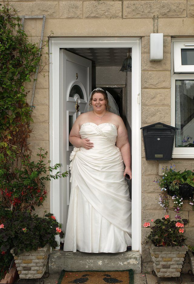 I wouldn't wear a traditional gown like this but I love to pin images of plus brides as the popular media totally ignores them.  This bride is stunning - womanly and feminine.