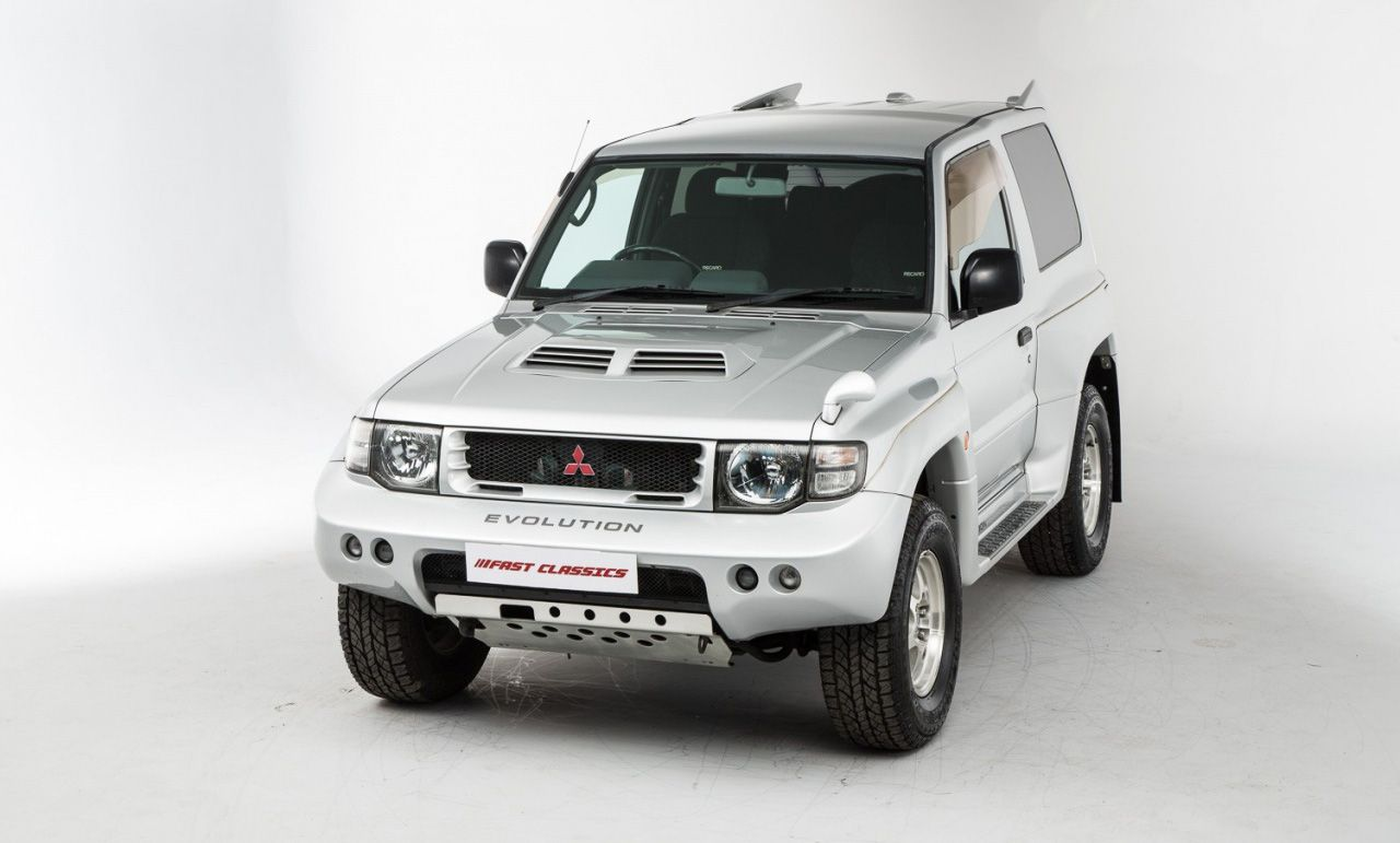 Mitsubishi pajero evolution lifted metal pinterest for Garage mitsubishi paris