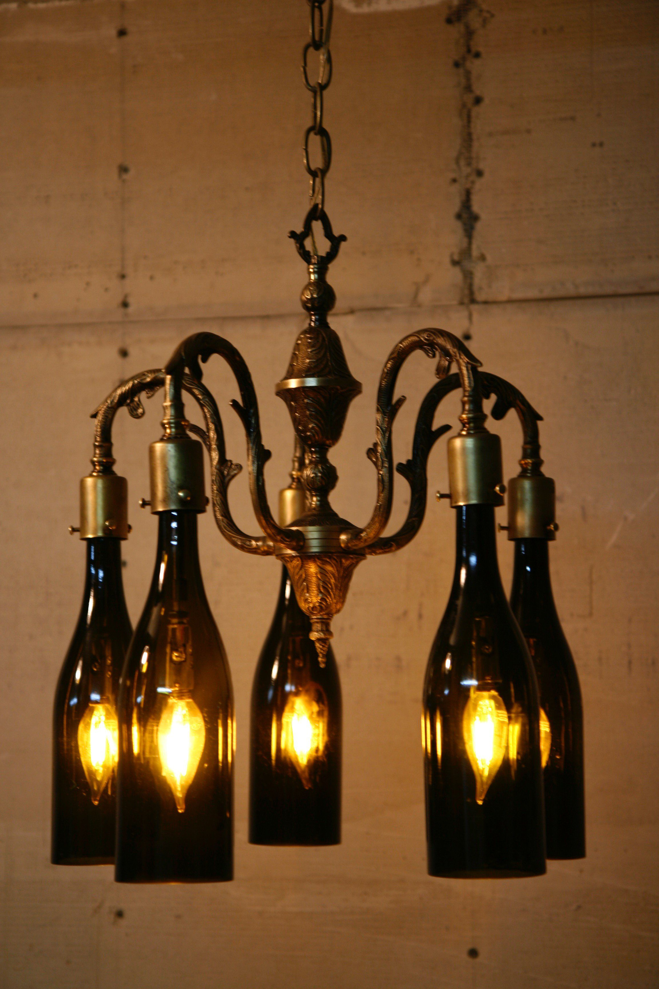 c73199b14d9b Recycled Antique Chandelier Using Wine Bottles As Globes | Garage ...