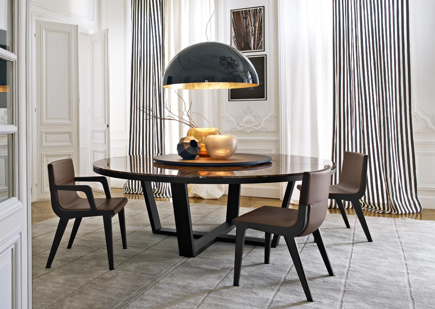 Round dining table Designed by Antonio Citterio for contemporary dining room sets.