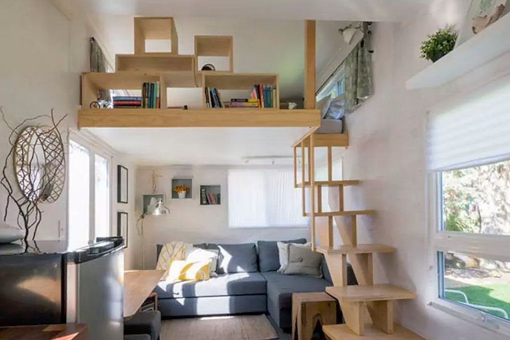 Bright Tiny House Feels Like A Modern Urban Loft Space Tiny House Loft Tiny House Living Room Small Loft Spaces