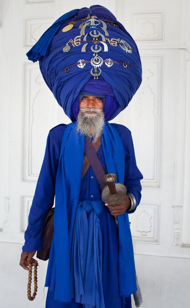 This man is a fully baptized Sikh whom I met at The Golden Temple. His turban is made of 30 meters of cloth and is decorated with the two primary symbols of Sikhism: the Khanda and the