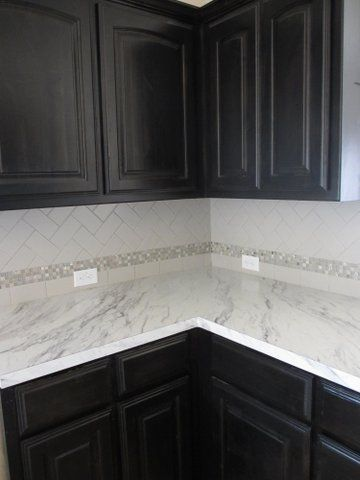 Mosaic accent tile white counter top dark cabinets for Mosaic tile bar top