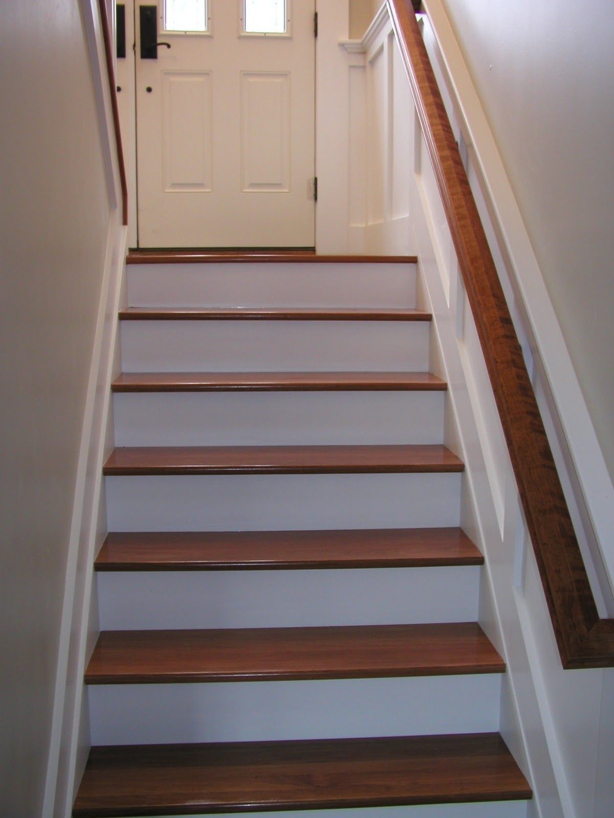 Horizontal Wainscoting In Stairs With Wood Handrail