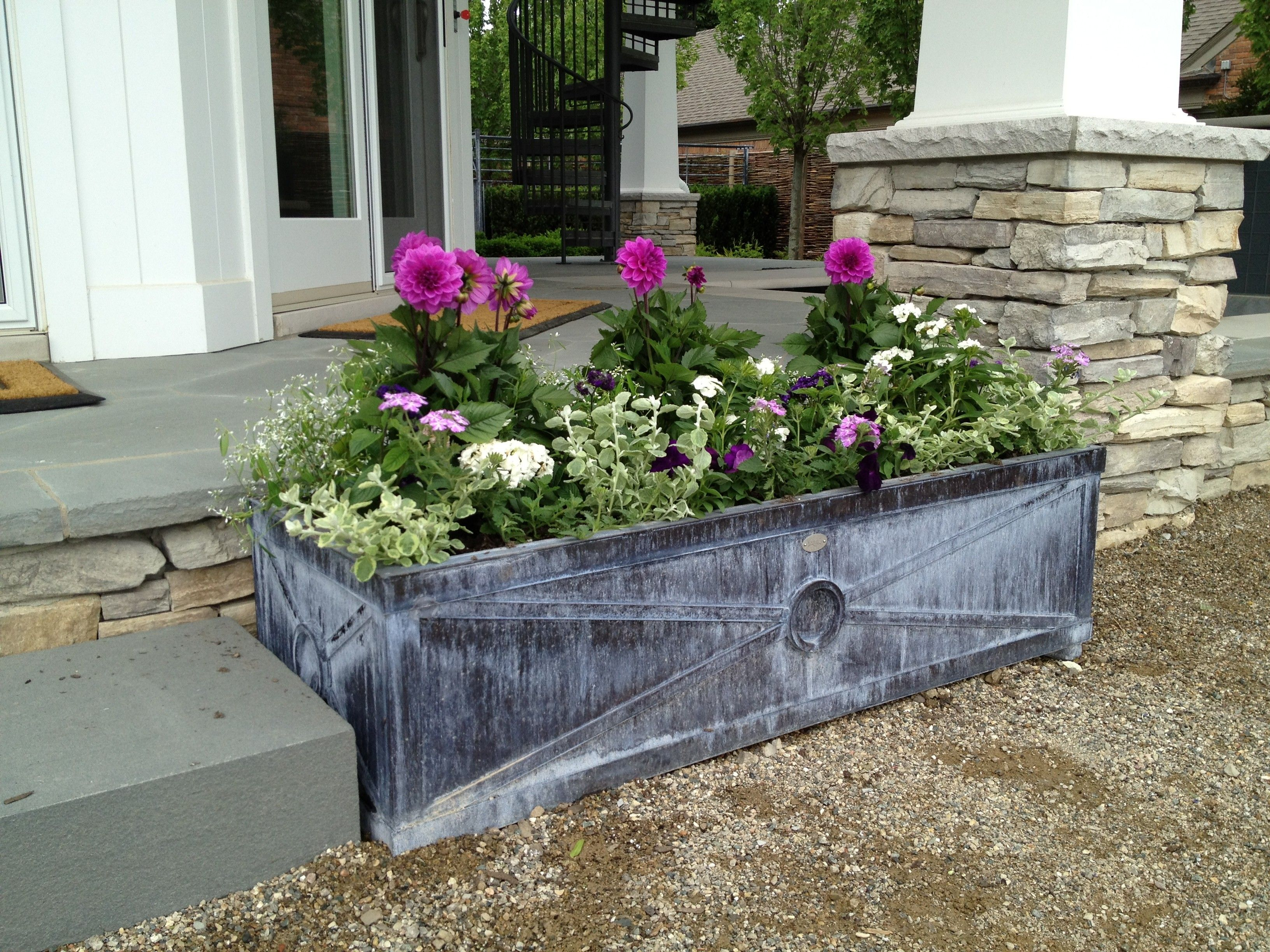 rectangular grey stone outdoor planter boxes with plants for
