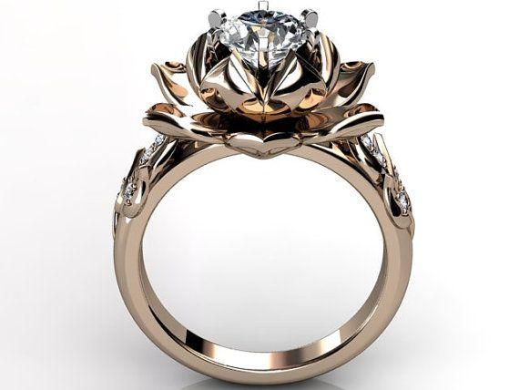 https://www.bkgjewelry.com/blue-sapphire-earrings/751-18k-yellow-gold-clip-on-diamond-blue-sapphire-earrings.html 14k rose gold diamond unusual unique lotus flower by Jewelice, $1380.00
