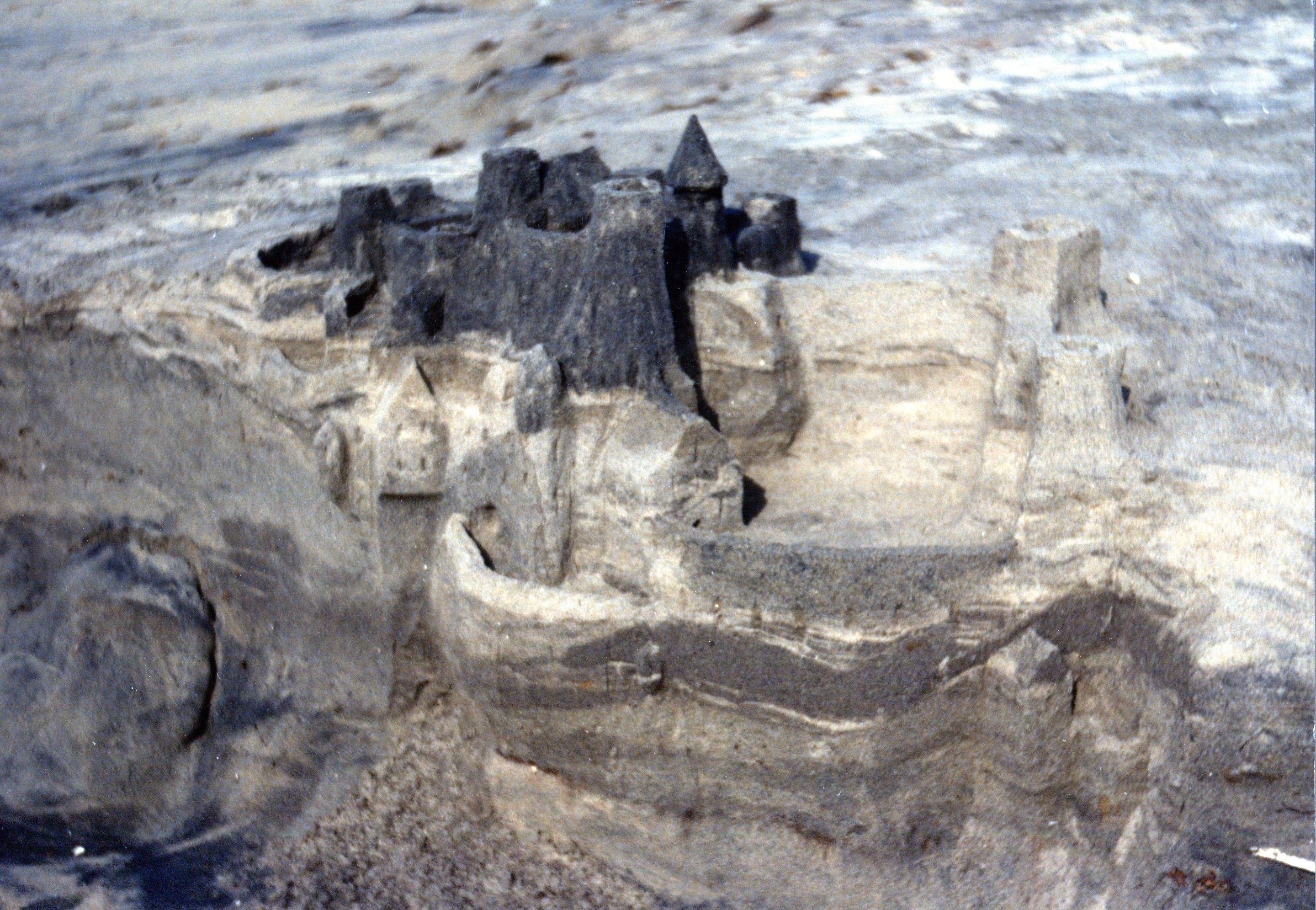 Sand castle.  It's made along a bank of sand.