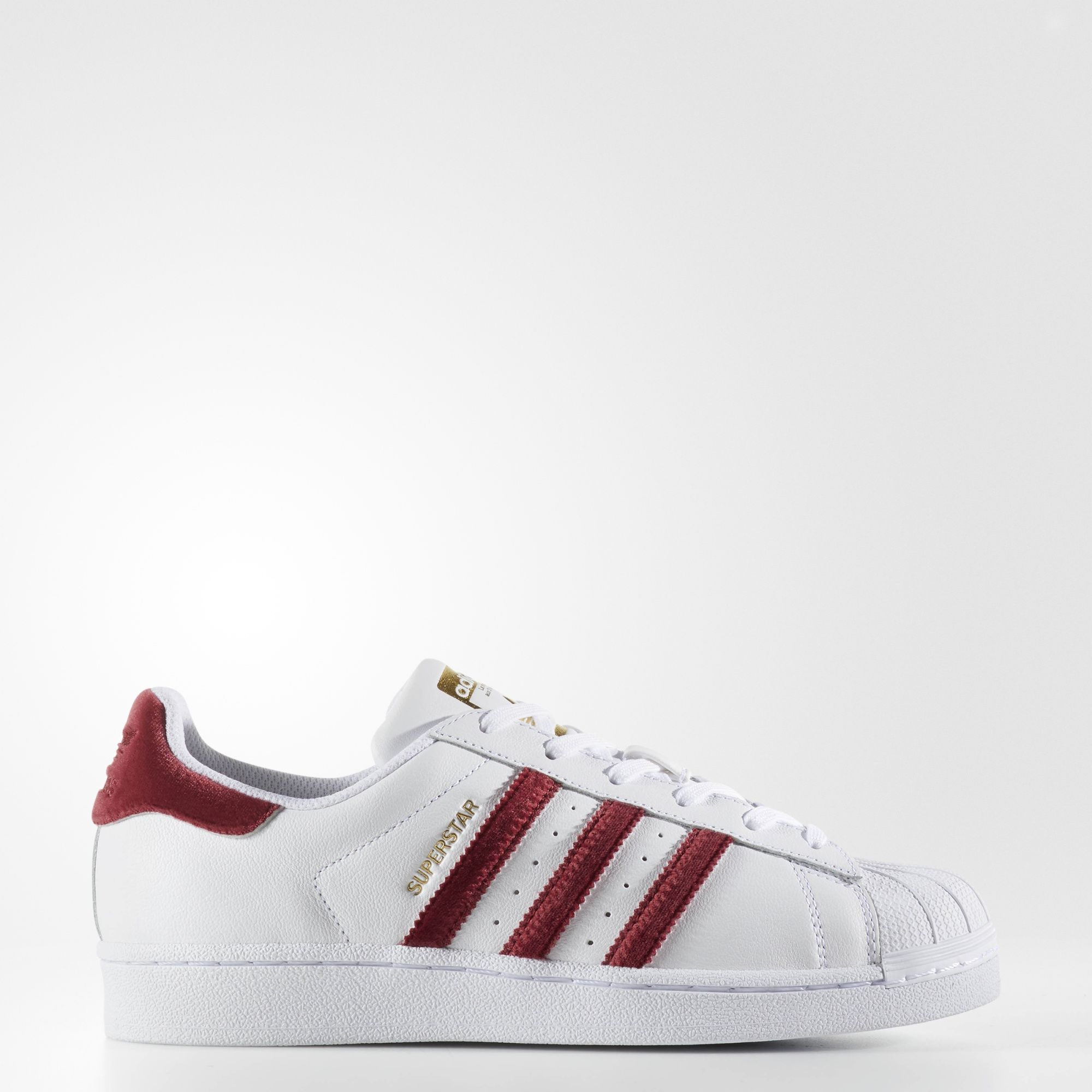 The adidas Superstar sneaker has been a streetwear legend for decades. This  women s version of the famous shell-toe design features a clean c72831e74