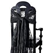 Lace draped chairs.