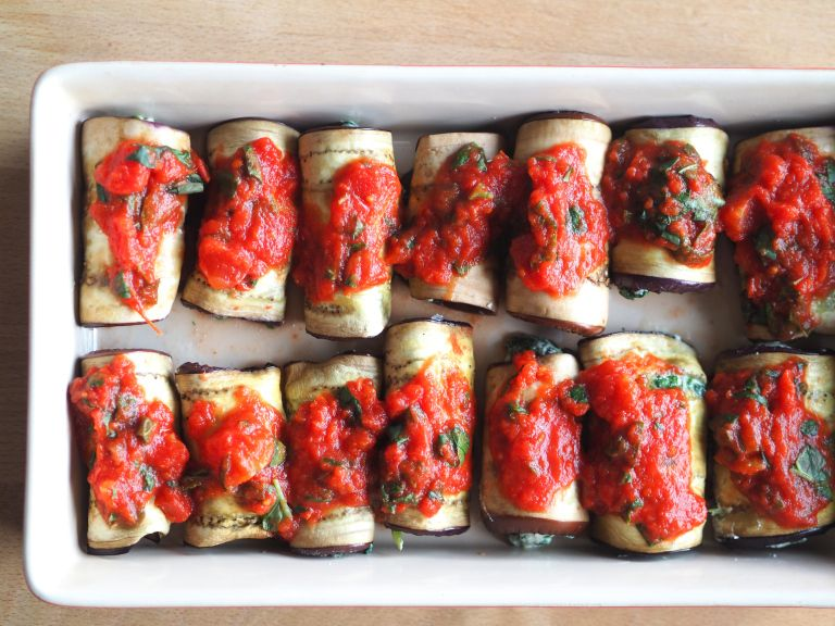 Aubergine rolls with spinach and ricotta cheese.
