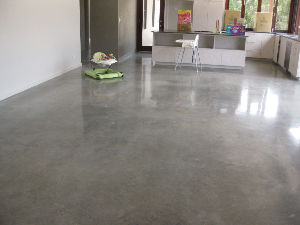 Elegant Look Sealed Concrete Floor In Grey With Stainless Steel Base Bar Stools And White Paint Wall