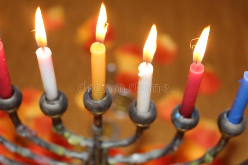 Jewish Festival of Lights Hanukkah holiday menorah candles In red blue white an