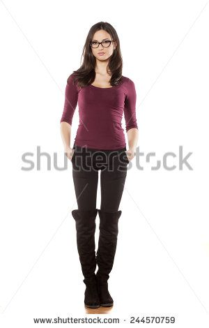 a15ab70fbfb2 front view of pretty young woman, standing on white background - stock photo