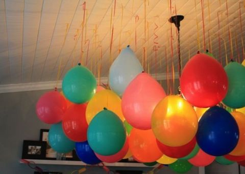 Balloons on strings in doorways instead of crepe paper or for Balloon decoration ideas without helium