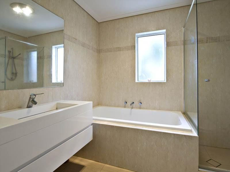 photo of a modern bathroom design with corner bath using marble from the bathroom galleries