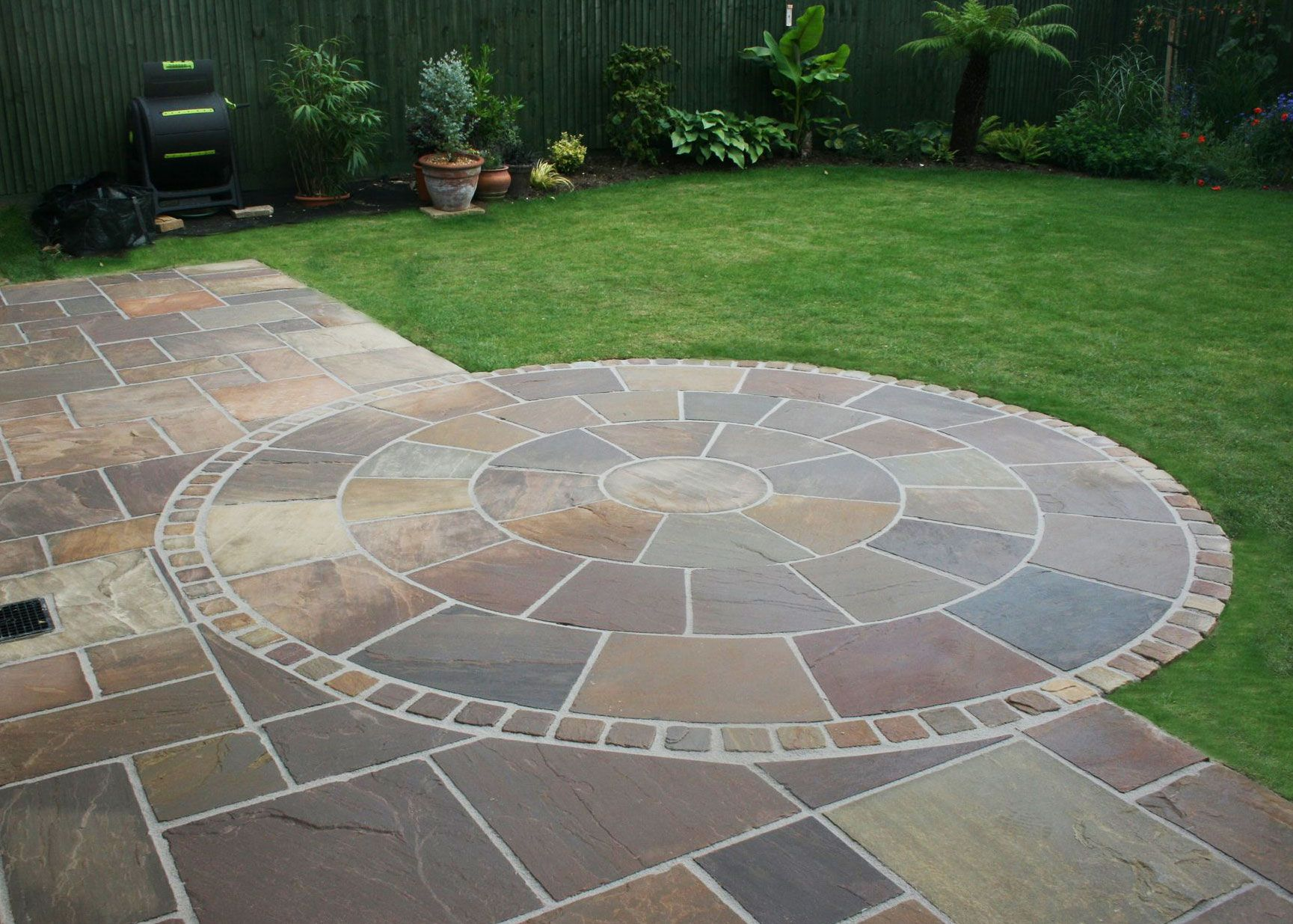 Decorative Indian Sandstone Circles Are A Striking Feature Piece To Any Patio Or Laid As A Feature In A G With Images Patio Garden Design Small Garden Design Sloped Garden