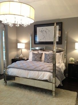 Mirrored four poster bed gray paint silver lamps and
