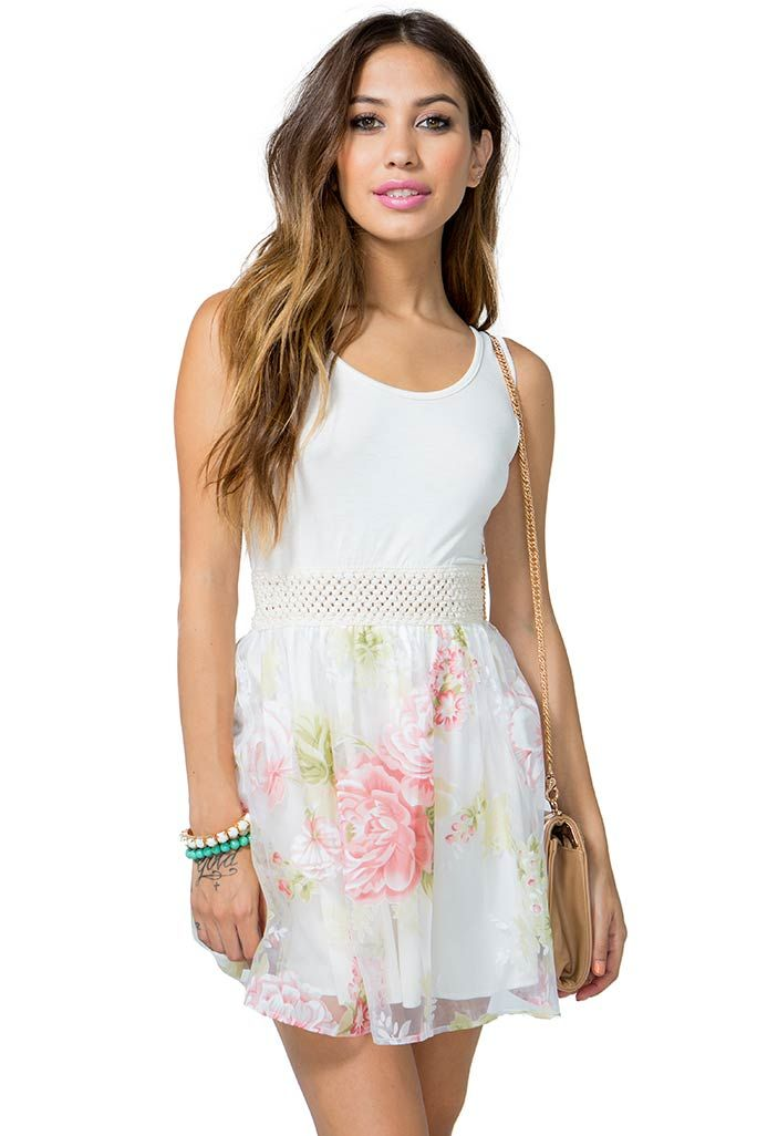 Be lovely for brunch in this sugary sweet poof dress! Solid knit bodice. Scoop neck and back. Sleeveless. Elasticized waist. Short floral printed organza skirt. Finished hem. Partially lined.