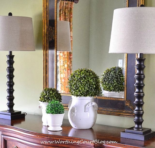 An Easy Spring Dining Room Vignette Made Up Of Various Sized Urns Topped With Faux Greenery