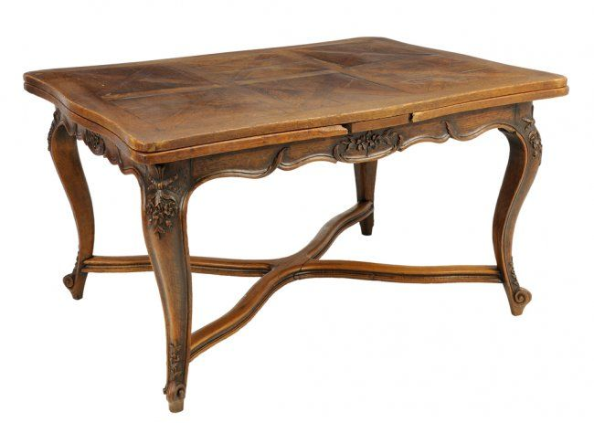 A French Provincial Style Oak Draw Leaf Dining Table Lot 48