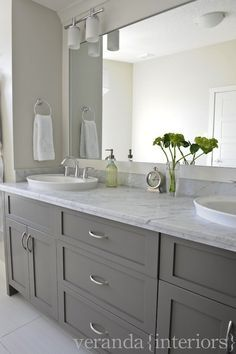 gray double sink vanity. cabinet color for master :: gray double bathroom vanity, shaker cabinets, frameless mirror, white oval vessel sinks, marble countertop. don\u0027t like sconces. sink vanity