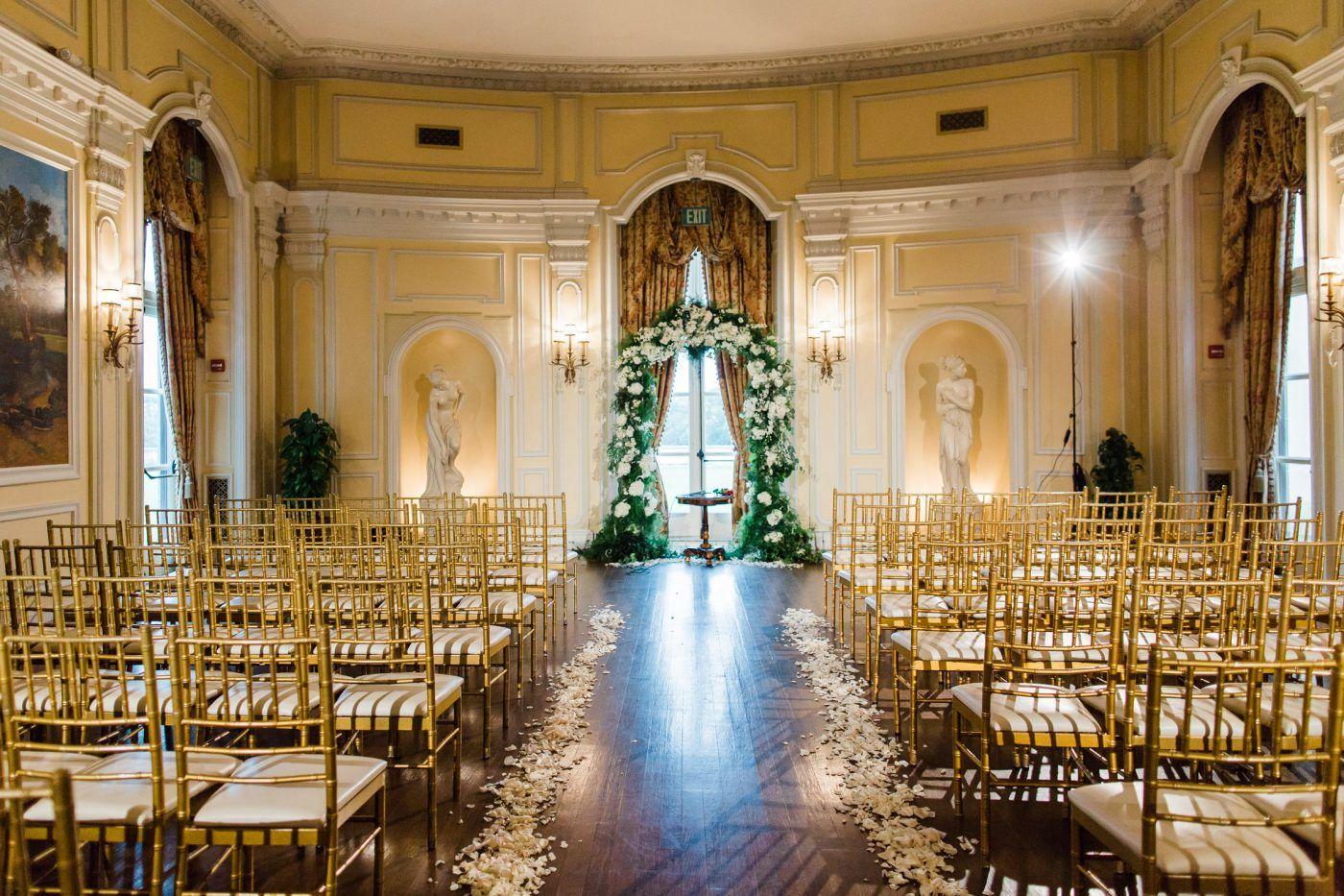 Oheka Castle Long Island Wedding Ayenia Nour Photography Indoor Ceremony Set Up With Gold Tiffany Chairs Long Island Wedding Oheka Castle Nyc Wedding