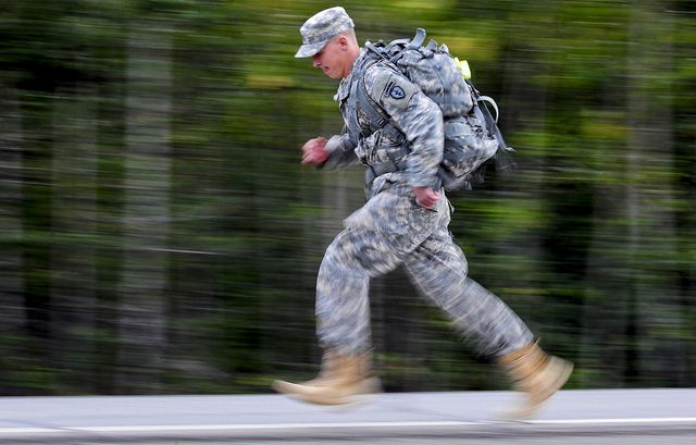 Private 1st Class William Stamey, 1st Squadron (Airborne) 40th Cavalry Regiment, of Canton, N.C., sprints during a Combat Cross-Country Series, 10-Mile Relay on the Davis Highway, Friday, Sept. 7, 2012. The relay consisted of five five-man teams in Army Combat Uniforms and combat boots racing for the best time with 35 lbs. rucksacks. (U.S. Air Force photo by Justin Connaher)