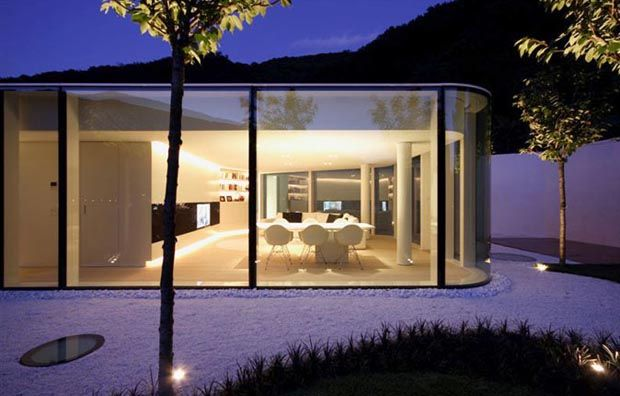 Italian studio JM Architecture has designed the Lake Lugano House, a 3,700 square foot polygonal glass house built around the lake in the south-east of Switzerland, at the border between Switzerland and Italy.