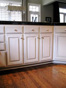 Beautiful off white cabinets with dark gray glaze - Off white cabinets with chocolate glaze ...