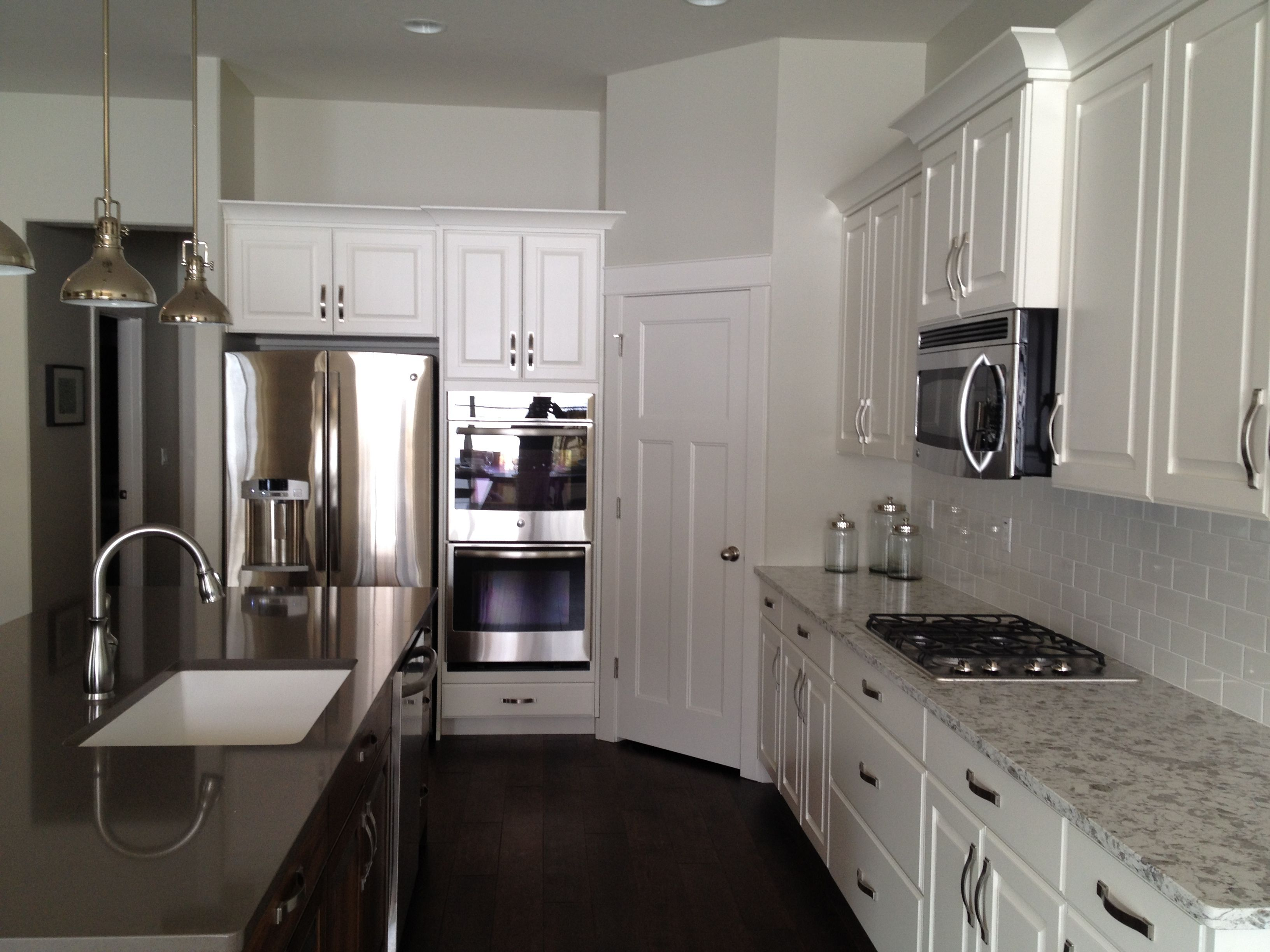 white painted perimeter cabinets with stained island and quartz countertops quartzite on kitchen island ideas white quartz id=48559