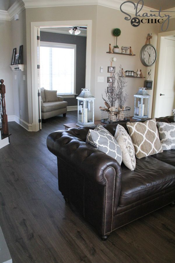 New flooring reveal and a giveaway plank gray and house for Brown furniture living room ideas
