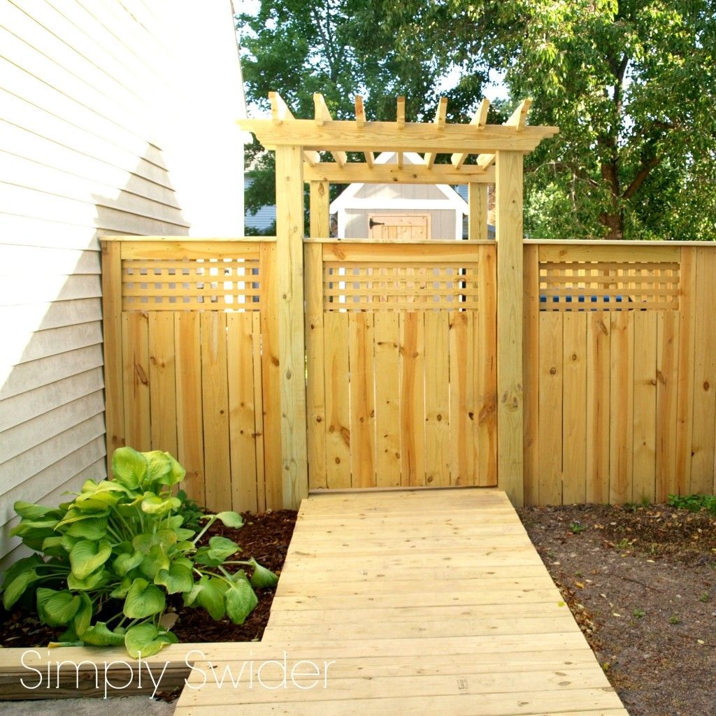 A beautiful fence and gate with an arbor simply swider for Fence with arbor
