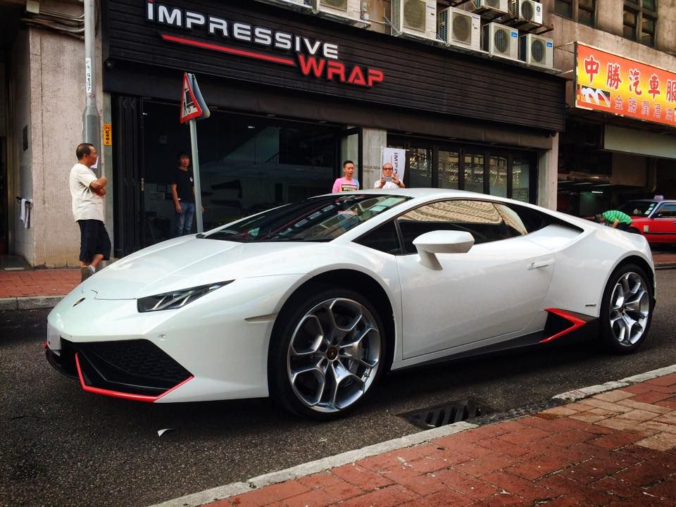 the owner of this lamborghini huracan was quite happy with the white paint job on his super car but wanted a twist something different that would set