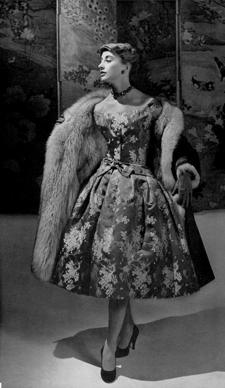 1954 Marie-Thérèse in lovely brown taffeta dress with lilac, silver and green floral print, the coat is brown lined with fox fur, by Christian Dior