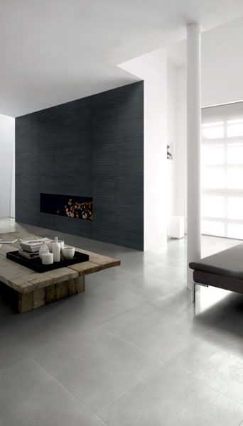 A contemporary living space which has the perfect tile combo! mandarinstone.com offers floor and wall tiles like these.