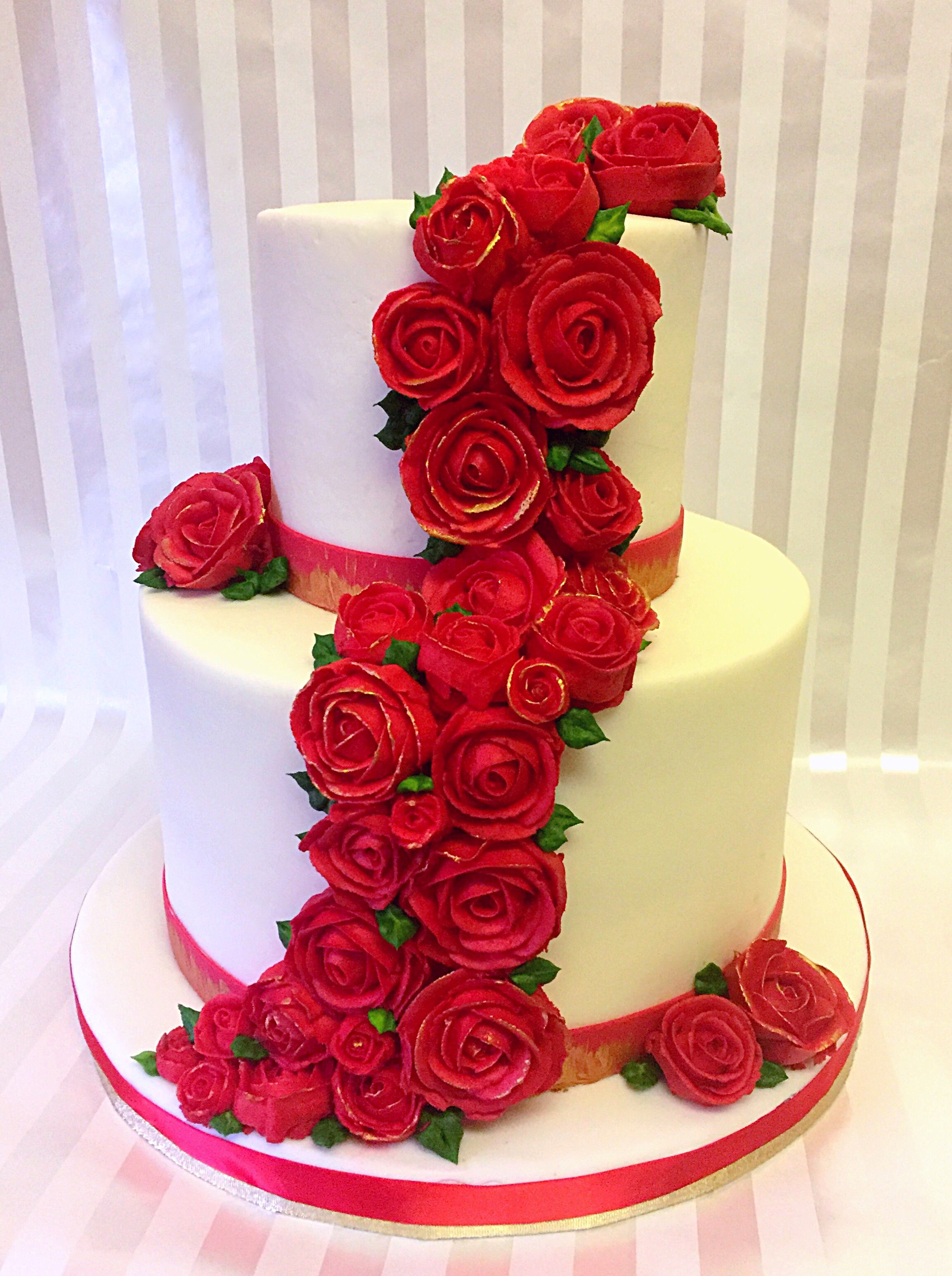 Cascading Red and Gold Roses Wedding Cake
