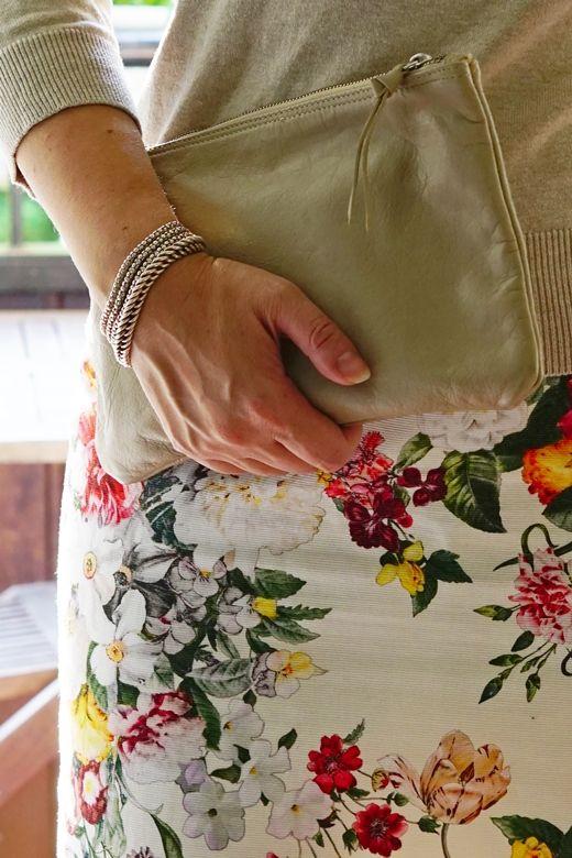 Clutch, flower pencil skirt and sterling silver bracelets