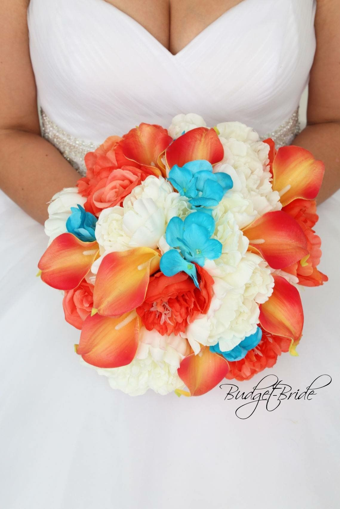Beach theme wedding bouquet with coral calla lilies and