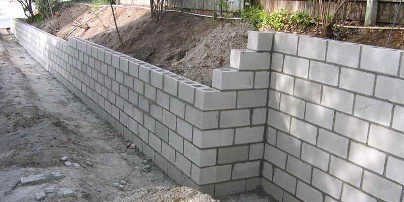 How Much Does It Cost To Build A Retaining Wall In 2019 Inch Calculator Building A Retaining Wall Retaining Wall Construction Concrete Block Retaining Wall