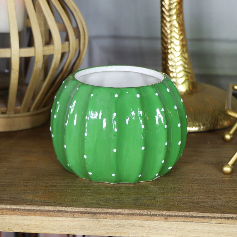 Green Cactus Plant Pot is part of Green Home Accessories Cactus - Give your plants and flowers a fun and funky home to flourish in with this quirky green cactus shape plant pot  Perfect for displaying your best blooms in great style  Made to look like a cactus that stands out and helps to create a fun look to your home  A great gift idea for a gardener and anyone that loves cacti