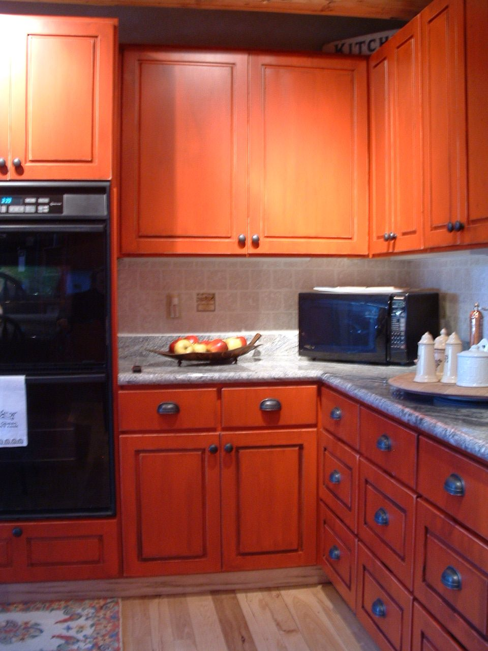 Bright red distressed cabinets with black accent glaze ...