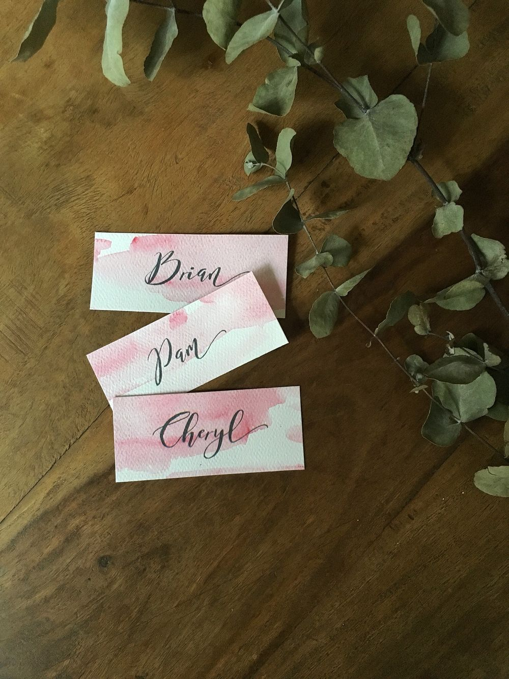 Handmade watercolour wedding name tags by laura elizabeth design