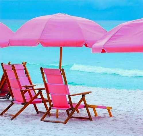 pink umbrellas and beach chairs