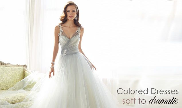 Colored Wedding Dresses from pretty pastels to bold black lace overlays. Find the latest styles for colored wedding dresses. http://www.maweddingguide.com/bridalfashions/gown/wedding-dresses-color.htm #coloredbridalgowns